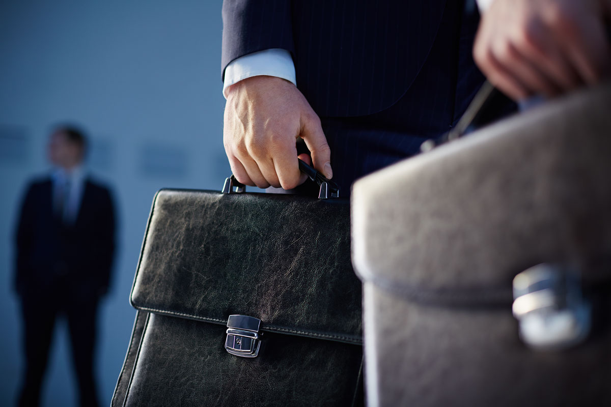 close-up-of-workers-with-briefcases